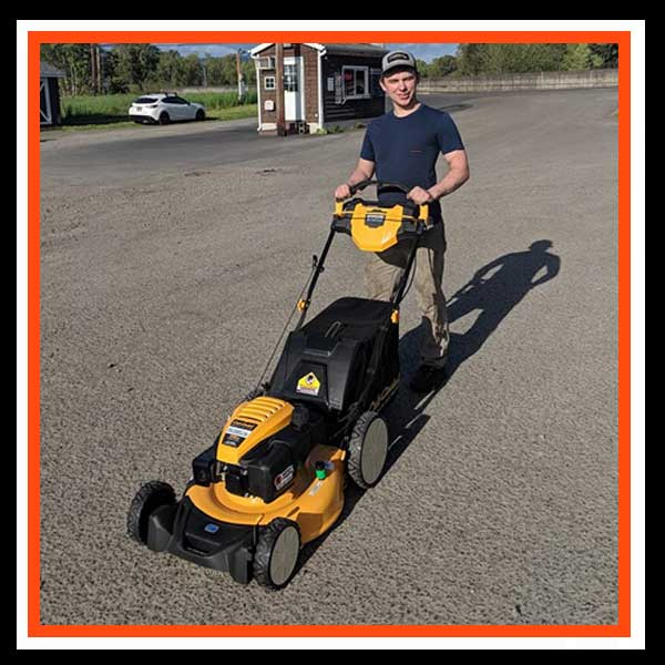 Brandon with walk behind mower